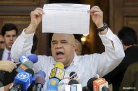 Jesus Torrealba, secretary of Venezuela's coalition of opposition parties (MUD), shows a copy of the form to collect signatures to begin the process of seeking a referendum to remove President Nicolas Maduro during a news conference in Caracas, Venez