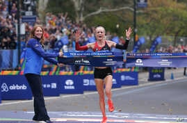 Shalane Flanagan crosses the finish line first in the women's division of the New York City Marathon in New York,  Nov. 5, 2017.