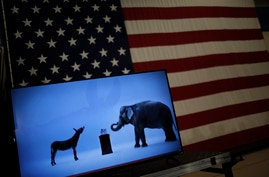 The mascots of the Democratic and Republican parties, a donkey for the Democrats and an elephant for the GOP, are seen on a video screen at Democratic US presidential candidate Hillary Clinton's campaign rally in Cleveland, Ohio, March 8, 2016.