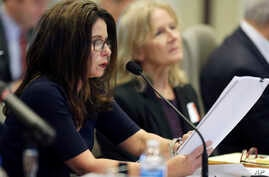 Executive director of the Board of Elections Kim Strach questions the first witness during the public evidentiary hearing on the 9th Congressional District investigation, Feb. 18, 2019, at the North Carolina State Bar in Raleigh, N.C.