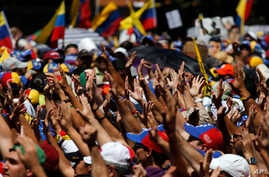 Supporters greet Carlos Vecchio, the national political coordinator of the Popular Will party, an anti-government group formed by jailed opposition leader Leopoldo Lopez,  during an anti-government protest in Caracas, Venezuela, March 22, 2014.