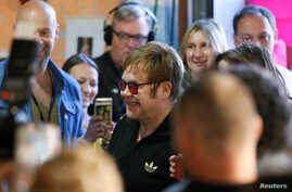 British musician Elton John (C) attends a charity event to support innovative HIV prevention and to raise awareness about AIDS in Kiev, Ukraine, May 28, 2018.