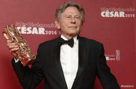 "FILE - Director Roman Polanski poses with his Best Director award for ""La Venus A La Fourrure"" (""Venus in Fur"")  at the 39th Cesar Awards ceremony in Paris, Feb. 28, 2014."