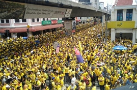 Protesters occupy a street during a rally in downtown Kuala Lumpur, Malaysia, Saturday, Nov. 19, 2016. Tens of thousands of yellow-shirt protesters rallied Saturday in Kuala Lumpur seeking Malaysian Prime Minister Najib Razak's resignation over a fin...