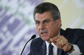 Brazilian Planning Minister Romero Juca talks to reporters about a leaked phone recording at his offices in Brasilia, Brazil, May 23, 2016.