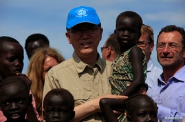 U.N. Secretary-General Ban Ki-moon (C) carries a child displaced by the region's conflict during his visit to an IDP (internally displaced persons) camp in the United Nations Mission in South Sudan (UNMISS) base at Thong Ping in Juba, May 6, 2014.