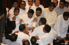 Scuffles between Sri Lanka's parliament members are seen during the parliament session in Colombo, Sri Lanka, Nov. 15, 2018.