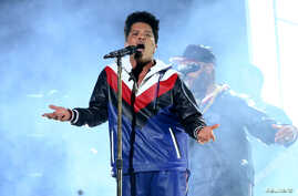 FILE - Bruno Mars performs at the 59th Annual Grammy Awards in Los Angeles, California.
