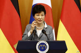 South Korean Park Geun-hye speaks during a joint press conference with her German counterpart Joachim Gauck after their meeting at the presidential house in Seoul, South Korea, Oct. 12, 2015.