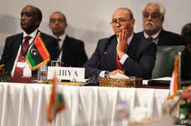 Libyan Foreign Minister Mohamed Abdelaziz, second left, attends a Cairo gathering of foreign ministers of Libya's neighbors in Cairo, Aug. 25, 2014.