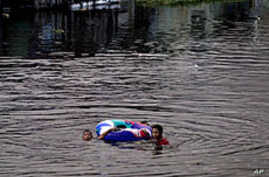 Aid Groups Call for Focus on Children in Flood Hit South East Asia