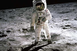 "July 1969: Astronaut Buzz Aldrin walks on the surface of the Moon near the leg of the Lunar Module (LM) ""Eagle"" during the Apollo 11 extravehicular activity (EVA). Astronaut Neil Armstrong, commander, took this photograph with a 70mm lunar surface ca"
