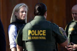 FILE - U.S. Department of Homeland Security Secretary Kirstjen Nielsen (L) speaks with Border Patrol agents near a newly fortified border wall structure, Oct. 26, 2018, in Calexico, Calif.
