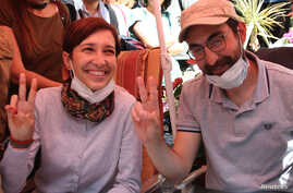 Nuriye Gulmen, a literature professor, and Semih Ozakca, a primary school teacher, who have been on hunger strike after they both lost their jobs in a crackdown following a failed July coup against President Tayyip Erdogan, take part in a protest aga...