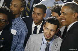U.S. President Barack Obama, right, poses with students at New York's Lehman College after announcing the launch of My Brother's Keeper Alliance, May 4, 2015.