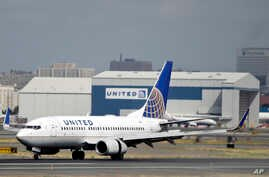 FILE -  United Airlines passenger plane lands at Newark Liberty International Airport in Newark, N.J.