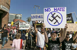 Demonstrators decrying hatred and racism following a white supremacist rally in Charlottesville, Virginia, march in downtown Los Angeles, California, Aug. 13, 2017.