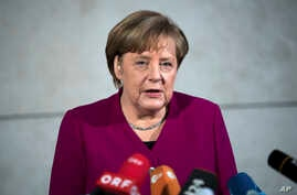 German chancellor Angela Merkel delivers a statement in Berlin, Jan. 7, 2018.