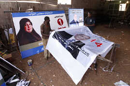 Workers prepare election campaign posters for Libya's House of Representatives in Tripoli June 18, 2014