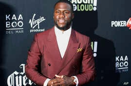 """FILE - Kevin Hart poses at Kevin Hart's """"Laugh Out Loud"""" new streaming video network launch event at the Goldstein Residence in Beverly Hills, California, Aug. 3, 2017. Hart pledged $25,000 to Hurricane Harvey relief efforts Sunday, Aug. 27, 2017, an"""