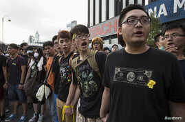 Student protesters shout slogans outside the Golden Bauhinia Square, venue of the official flag-raising ceremony for celebrations of China's National Day, in Hong Kong Oct. 1, 2014.
