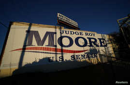 A banner promoting Republican Senatorial candidate Roy Moore is pictured on the side of a building in Birmingham, Alabama, U.S., December 10, 2017.