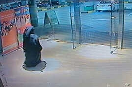 This image made from video released by the Abu Dhabi police department on Dec. 2, 2014 shows a veiled suspect in the stabbing of an American teacher in a shopping mall restroom as seen on security camera footage in Abu Dhabi, UAE.