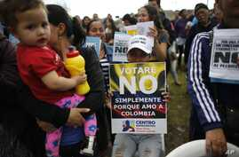 """Opponents to the peace deal signed between the Colombia government and rebels of the Revolutionary Armed Forces of Colombia, FARC, attend an event to promote the """"No"""" vote in the upcoming referendum in Bogota, Colombia, Oct 1, 2016."""