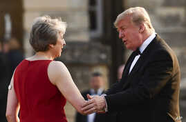 Britain's Prime Minister Theresa May welcomes President Donald Trump ahead of a black-tie dinner at Blenheim Palace in London, July 12, 2018.