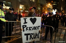 A supporter of President-elect Donald Trump shouts back at opposing demonstrators during a protest against the President-elect in Manhattan, New York, Nov. 11, 2016.