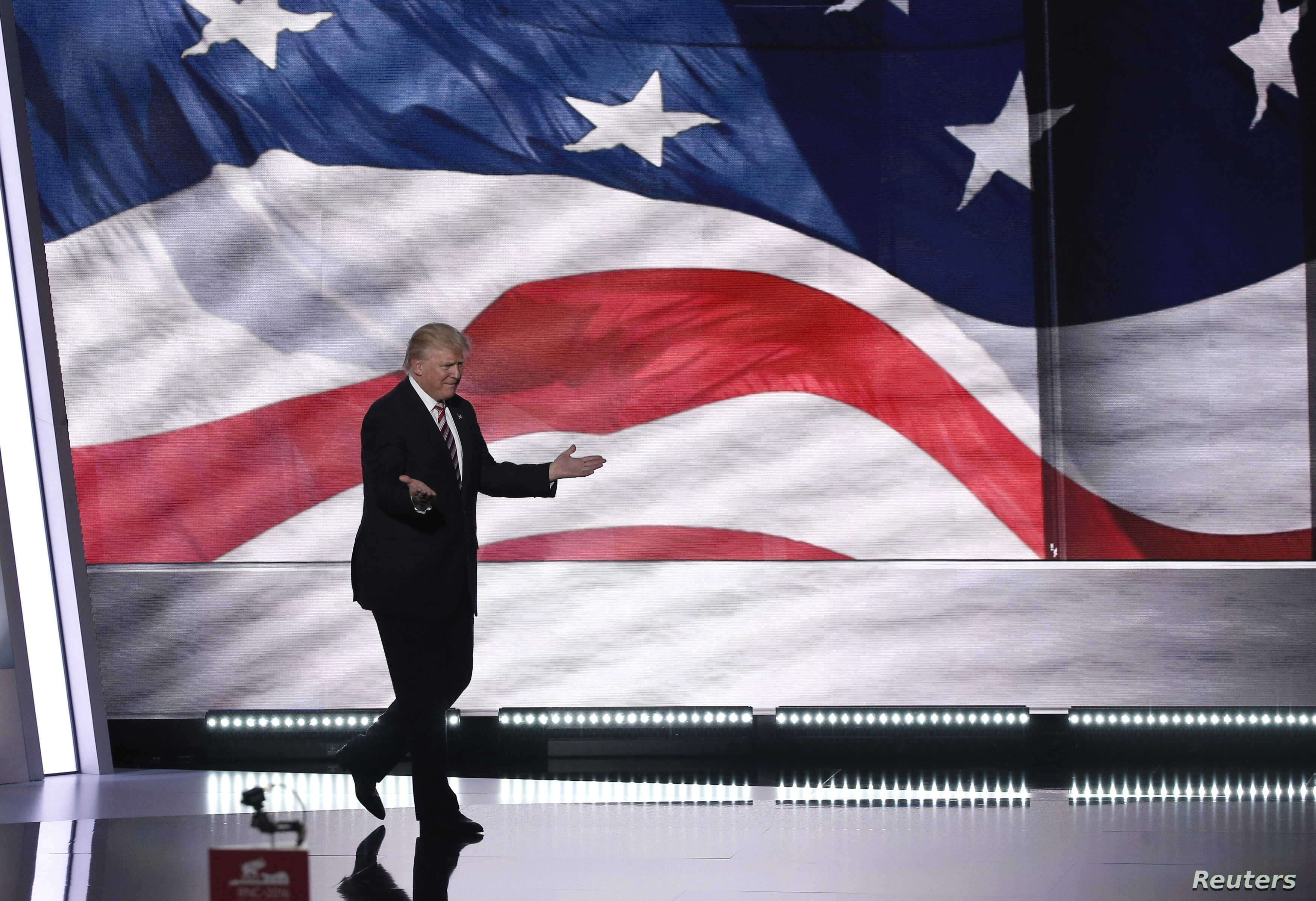 Republican U.S. presidential nominee Donald trump takes the stage near the end of the third day of Republican National Convention in Cleveland, Ohio, U.S. July 20, 2016.