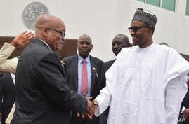 South Africa's President, Jacob Zuma, left, is welcomed by Nigeria's President Muhammadu Buhari during an official visit at the Presidential Palace in Abuja, Nigeria, Tuesday, March 8, 2016.