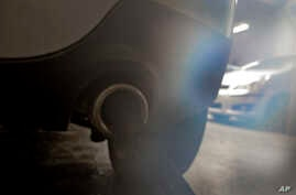 Exhaust fumes escape from the exhaust of a diesel engine car in Paris, Oct.14 2015.