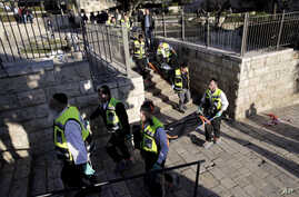 Israeli ZAKA emergency response members carry the bodies of  Palestinians at the scene of a shooting attack near the Damascus gate, Jerusalem's Old City, Feb. 3, 2016.