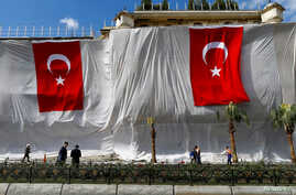 Buildings are seen covered and decorated with Turkish flags after Tuesday's car bomb attack on a police bus, in Istanbul, June 8, 2016.