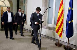 Catalonia regional President Carles Puigdemont arrives for a statement after signing the decree officially calling for the vote on a binding independence referendum, following a plenary session at the Parliament of Catalonia in Barcelona, Spain, Sept