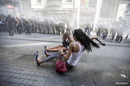 Riot police use a water cannon to disperse LGBT rights activist before a Gay Pride Parade in central Istanbul, Turkey, June 28, 2015.