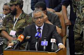 Libyan Prime Minister Ali Zeidan says he will form a new government following days of turmoil.