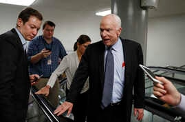 Sen. John McCain, R-Ariz., talks to reporters on Capitol Hill in Washington, Wednesday, Oct. 18, 2017.