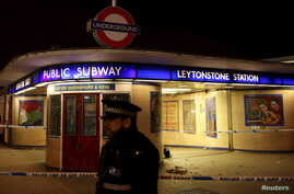 Police officers investigate a crime scene at Leytonstone underground station in east London, Britain Dec. 6, 2015.