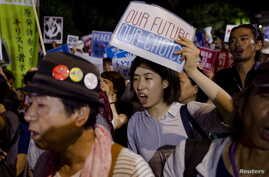 Members of Students Emergency Action for Liberal Democracy shout slogans during a protest outside parliament in Tokyo, Aug. 21, 2015.