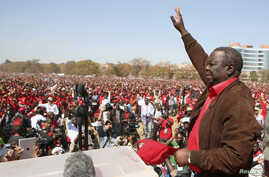 Leader of Zimbabwe's opposition party Movement For Democratic Change (MDC) Prime Minister Morgan Tsvangirai greets supporters at a rally in Harare, July 29, 2013.