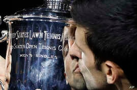 Novak Djokovic, of Serbia, kisses the trophy after defeating Juan Martin del Potro, of Argentina, during the men's final of the U.S. Open tennis tournament, Sunday, Sept. 9, 2018, in New York.