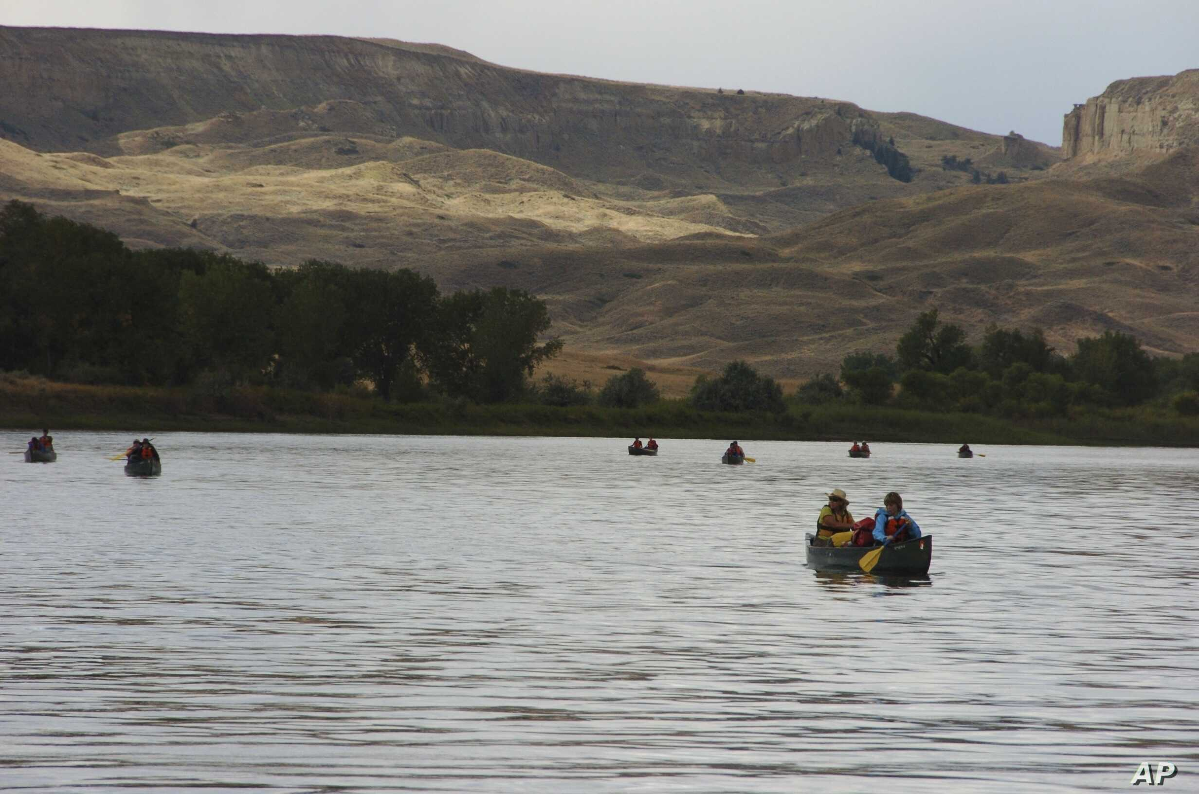 FILE - A group canoes through the Upper Missouri River Breaks National Monument near Fort Benton, Montana, Sept. 19, 2011.