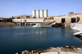 FILE - This photo shows a general view of the dam in Mosul, 360 kilometers (225 miles) northwest of Baghdad, Iraq.