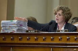 U.S. Rep. Susan Brooks, R-Ind., at a House hearing on the attacks on the U.S. consulate in Benghazi in 2012, presents copies of a collection of emails that she said suggested that the Obama administration and former Secretary of State Hillary Clinton