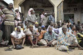 FILE - Somalians come out onto the streets after the government and AU troops drove al-Shabab militants from their community as part of their military offensive dubbed Indian Ocean aiming to oust al-Shabab from its last major hideouts.