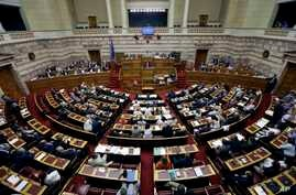 FILE - Greece's Prime Minister Alexis Tsipras delivers a speech during an emergency parliament session in Athens, July 23, 2015.