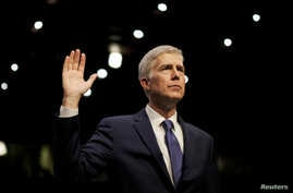 FILE - U.S. Supreme Court nominee judge Neil Gorsuch is sworn in to testify at his Senate Judiciary Committee confirmation hearing on Capitol Hill in Washington, March 20, 2017.