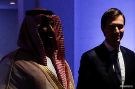 FILE - Saudi Arabia's Prince Mohammed bin Salman escorts White House senior advisor Jared Kushner  at the Global Center for Combatting Extremist Ideology in Riyadh, Saudi Arabia May 21, 2017.